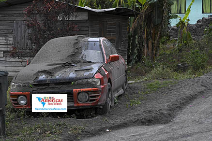 ash-covered-car-and-road-in-chateaubelair-st-Vincent-naan-image